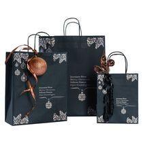 Kersttassen en geschenkzakjes